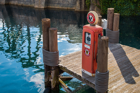 A replica vintage gas pump on a replica pier.