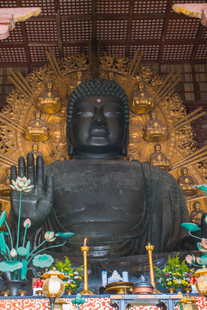 The giant, sitting Buddha statue inside Todaiji Temple.