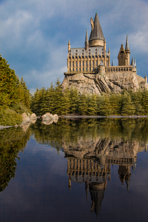 Replica Hogwarts school of wizardry reflected on the lake.