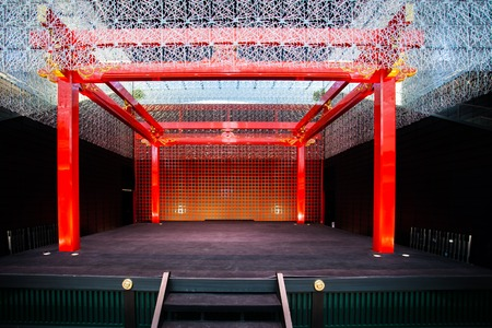 A performance stage adorned with japanese decor.