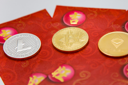 Crypto currency coins on top of traditional red envelope gift packets