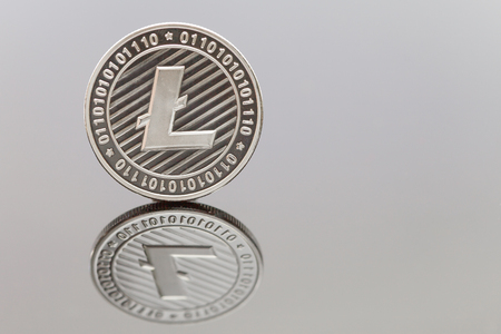 A solo Litecoin coin reflected on a white background Stock Photo