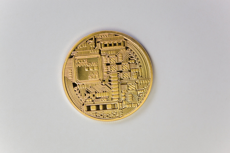 The opposite side of a  golden tech coin. Stock Photo