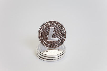 A stack of Litecoin coins on a white background.