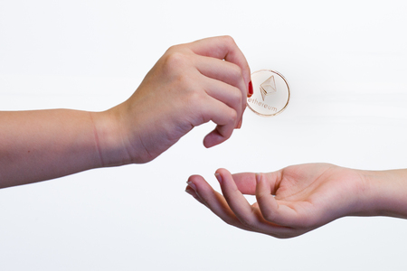 Close up of an exchange of a crypto currency coin