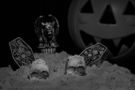 Halloween night scene with Jack O Lanterns, tombstones, skulls and gargoyles Stock Photo