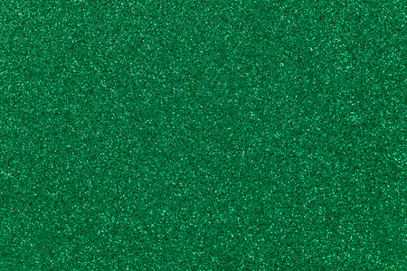 Dark green colored sand paper textured background with sparkles and glitters Stock Photo