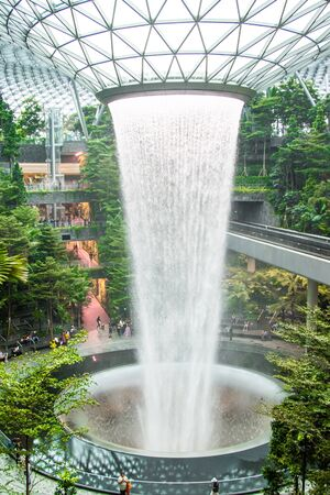 Full view of the Jewel at Changi waterfall at Changi Airport, Singapore