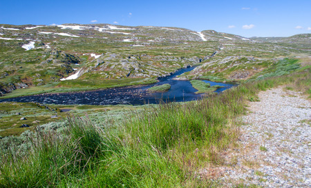 Norway. The district along the road through the pass in mountains. Summer, sunny day