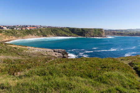 View of the town on the high coast ocean. Spain, suburb of Suances, summer day in the Province of Cantabria, it is photographed from Playa de Los Locos. Stock Photo