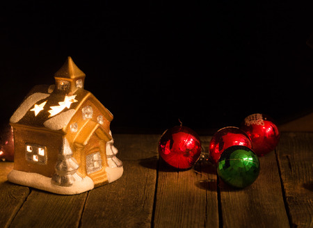christmas decorations against a dark background a toy lodge and new years multi colored