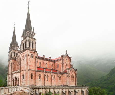 Basilica de Santa Maria in Spain, Covadonga. Foggy cloudy rainy day, the area around the temple it is covered with fog Stock Photo