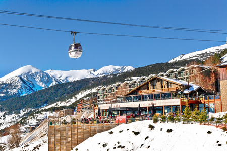 SOLDEU, ANDORRA - FEBRUARY 9, 2017: View of hotel in mountains in ski resort. An elevator cabin against the background of a terrace of hotel and snow tops. Sunny winter day Editorial