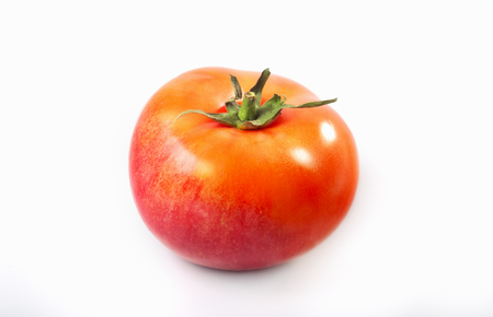 Hybrid of apple and tomato on a white background.