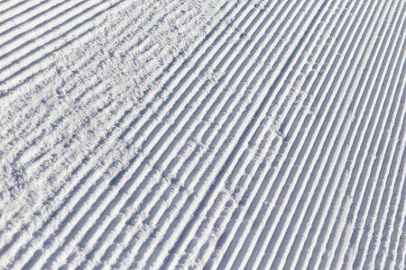 Snow on the prepared ski slopes sunny winter day Stock Photo