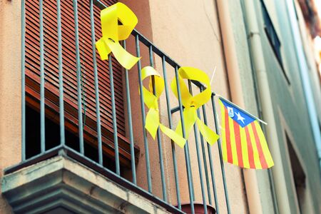 Flag of Catalonia on the balcony of a building in Barcelona. Symbol of independence of the Spanish region