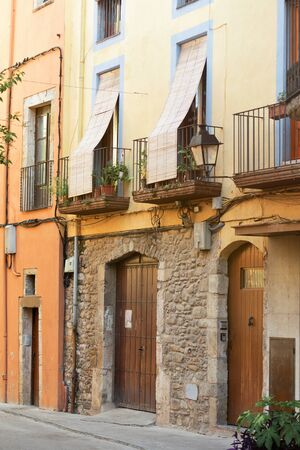 Balconies on an old stone building in Spain, on the second floor.
