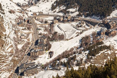 Top view of the modern village in the mountains of Andorra from far away in winter.
