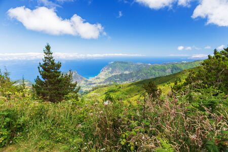 View of the ocean coast from the tops of the mountains on the island of Madeira, Portuga