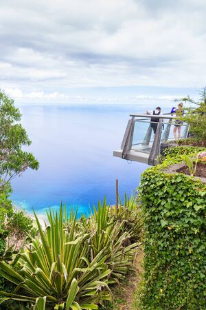 A glass-bottomed viewing point on the Cabo Girao cliff in Madeira, Portugal. From a height of 580 meters, wonderful views of the island and the ocean are open.