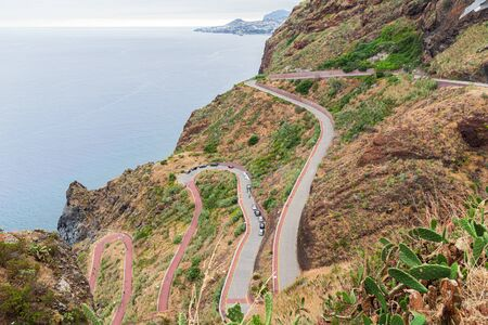 A winding serpentine road in the mountains of Madeira, spuso to the beach from the village.