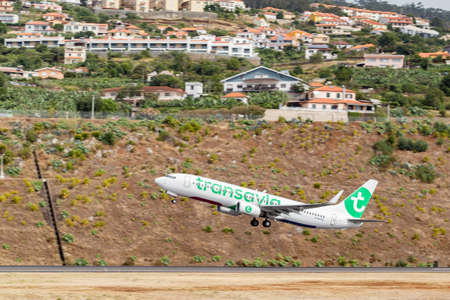 MADEIRA, PORTUGAL - AUGUST 3, 2018: Plane takes off from Madeira airport runway.