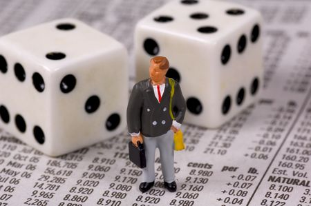 Miniature Businessman With a Briefcase Standing on Stock Quotes.