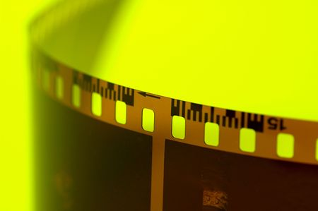 expose: Film Strip on Yellow Background.