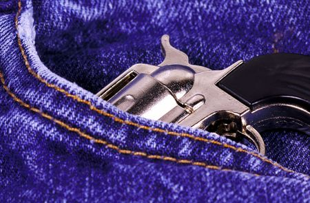 concealed: Gun in a Pocket Stock Photo