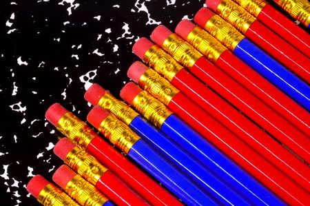 Red and Blue Pencils on a Composition Notebook. Stock Photo - 217632