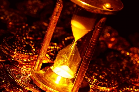 Hourglass and Gold Coins Archivio Fotografico