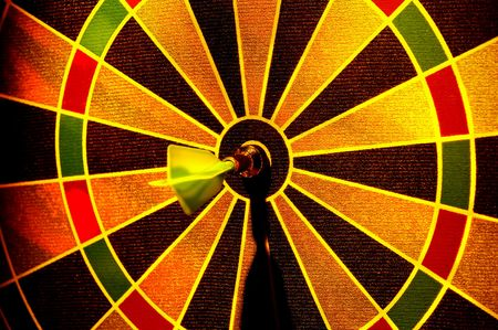 Dart in the Center of a Dartboard.