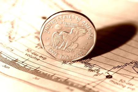 stock chart: Coin on a Stock Chart. Stock Photo