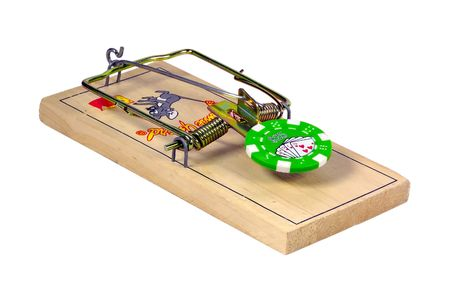 Isolated Mousetrap with a Poker Chip as Bait.  Gambling Addiction Concept.  Clipping Paths Included Banco de Imagens - 233070