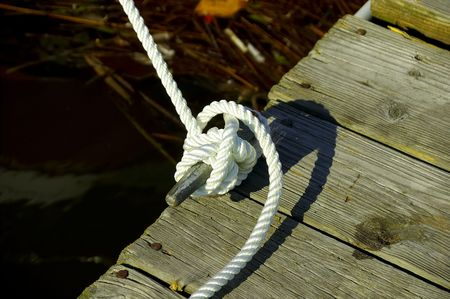 Photo of a Roped Tied Off To a Dock. Stock Photo - 238662