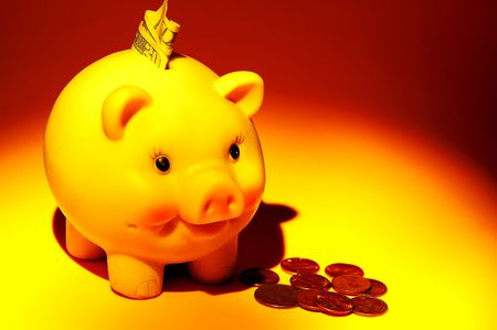 college fund savings: Photo of a Piggy Bank and Money