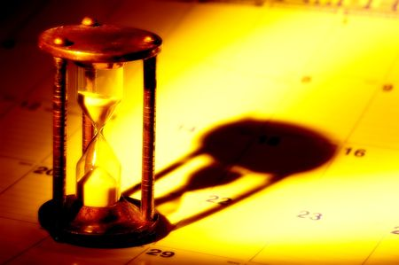 Hourglass on a Calendar With Creative Lighting.  See Portfolio For Similar Concepts.