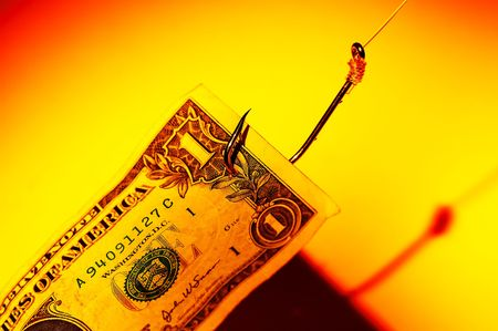 Dollar Bill on a Hook. Phishing Concept - New Email Scams To Beware of.