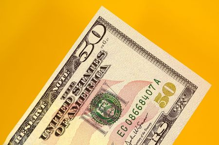 fifty dollar bill: Fifty Dollar Bill on a Yellow Background