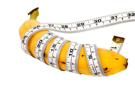 diet concept: Banana With a Tape Measure Wrapped Around It.  Diet Concept.