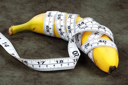 Banana With a Tape Measure Wrapped Around It.