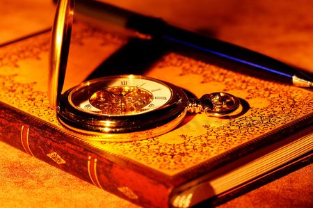 ledger: Vintage book and a Pocketwatch Stock Photo