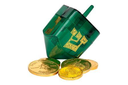 gelt: Green Dreidel and Gelt (Candy Coins) Stock Photo