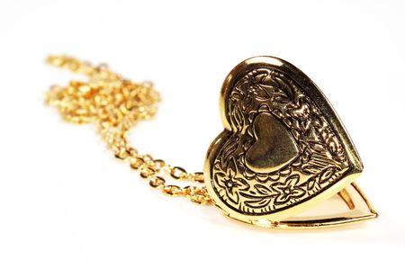medaglione: Foto di un medaglione in oro Cuore Archivio Fotografico