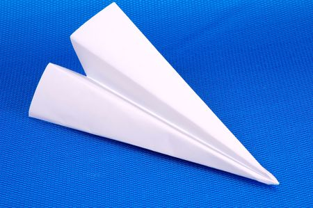 Paper Airplane on a Yellow Background Stock Photo