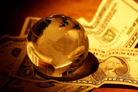 Glass Globe on Money With Creative Lighting.  Global Finance Concept Banco de Imagens