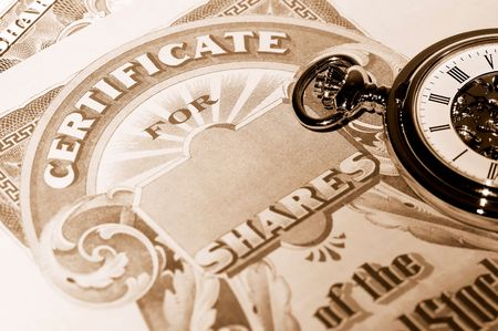 timing the market: Pocket Watch and Stock Certificates - Market Timing Concept