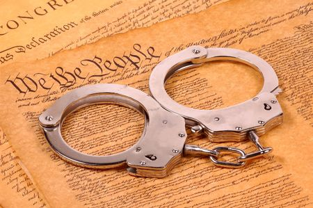 preamble: Declaration of Independence and Handcuffs - American Justice Concept