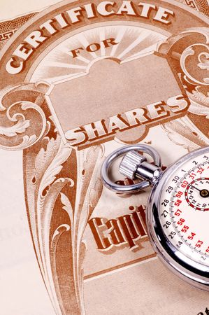 Stopwatch and a Stock Certificate - Market Timing Concept