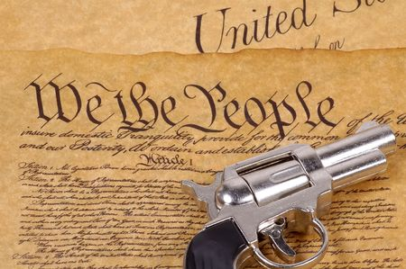 Declaration of Independence and a Gun.  RIght To Bare Arms Concept. photo